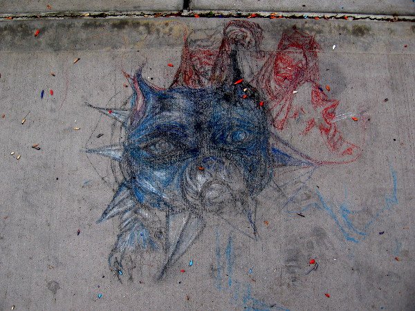 Blue face of a dog, afire with red nightmares, with eyes that are haunting.