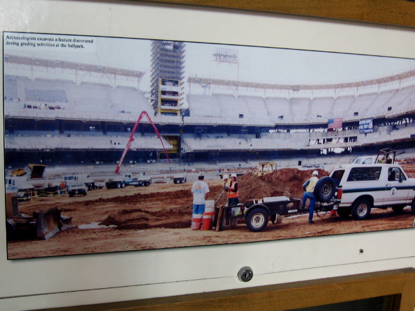 Photo taken during construction of Petco Park baseball stadium in East Village. Archaeologists excavate a feature discovered during grading activities at the ballpark.