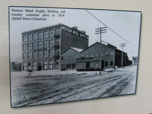 Old photo of Western Metal Supply building and foundry sometime prior to 1919. The preserved brick building is now a unique part Petco Park's structure.