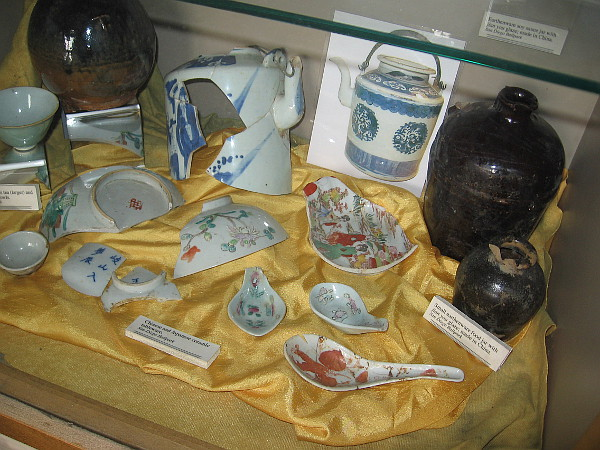 Fragments of earthenware jars and Chinese and Japanese ceramic tableware show Asian culture that thrived in the neighborhood's past.