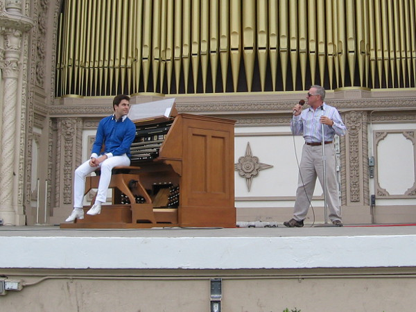 After a great organ rendition of Bohemian Rhapsody, Spreckels Organ Society's Executive Director Ross Porter announces kids are needed for the next number.