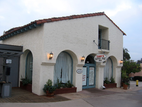 Photo of the Spanish Revival stucco Milton P. Sessions Nursery building in Old Town San Diego State Historic Park, designed by architect Richard Requa.