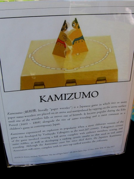 Kamizumo--paper wrestler--is a Japanese game in which folded paper sumo wrestlers are placed in an arena and controlled by vibrating the platform with finger taps.
