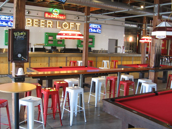 The Loft at Petco Park contains pool tables, a fun vibe and cool elements of the Western Metal Supply Co. Building's history that have been preserved.