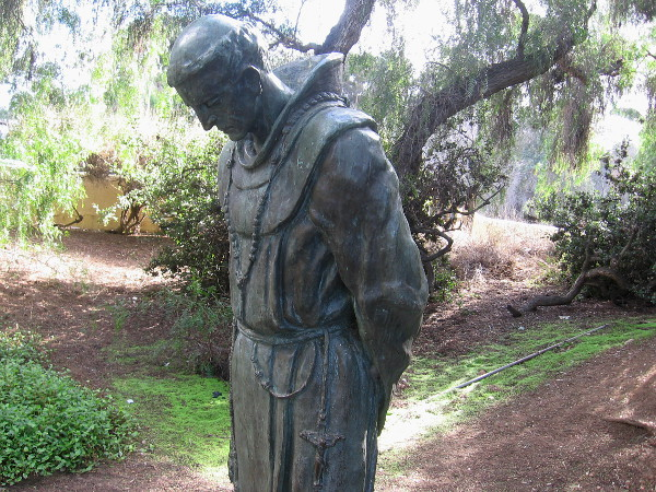 The Padre, by Arthur Putnam, 1908. The public artwork stands on a patch of grass among trees on Presidio Hill.