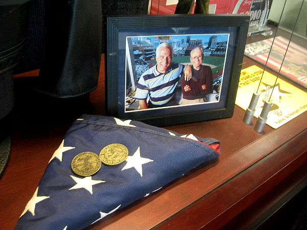 Inside a lounge area for the press is a glass display case full of memories from Jerry Coleman's life as baseball player, Marine aviator, and Padres broadcaster. The flag was presented to him upon his retirement by the military.