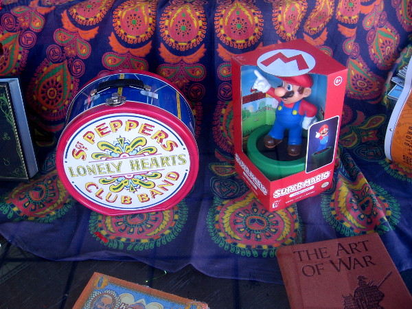 I also see a Sgt. Peppers Lonely Hearts Club Band tin tote and a Super Mario figure.