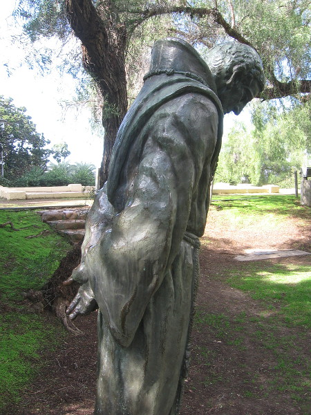 A quiet bronze statue among trees near San Diego's now ruined and vanished Presidio.