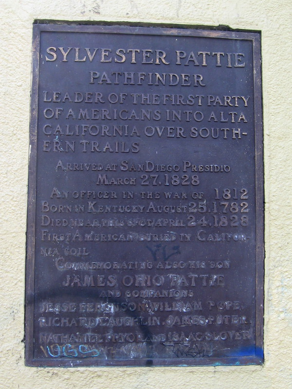The plaque begins: Sylvester Pattie, pathfinder, leader of the first party of Americans into Alta California over Southern trails. Arrived at San Diego Presidio March 27, 1828.