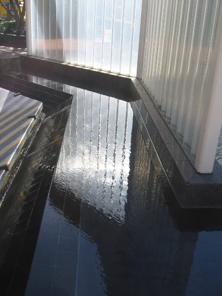Light reflecting from and passing through the prism wall reflects from a basin of water.