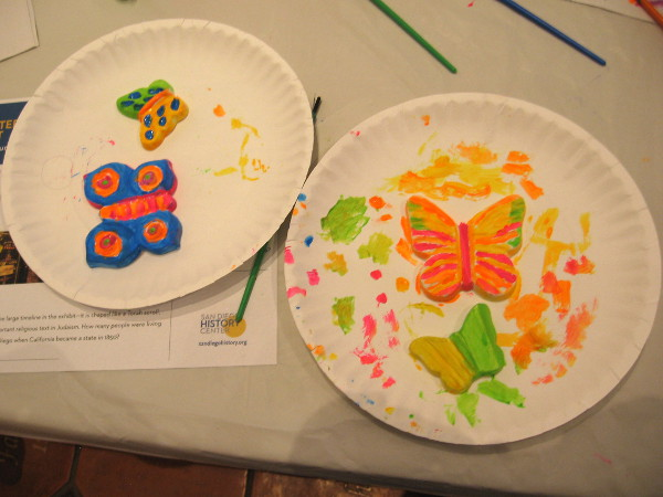 Ceramic butterflies are painted. Each one symbolizes a young person who died as a result of the Holocaust.