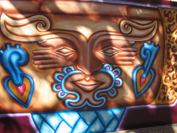 Close up of a colorful mural now on display in front of the San Diego Museum of Art.