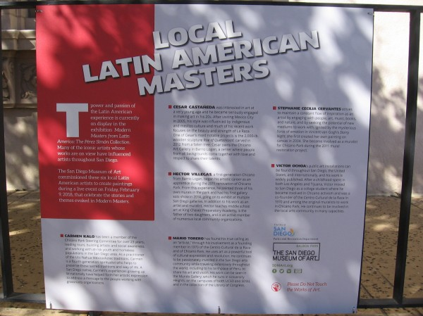 Sign in front of the San Diego Museum of Art explains the outdoor Local Latin American Masters exhibition. Six murals were painted live in front of the museum.