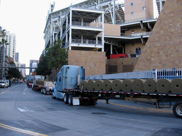 In late February, trucks haul in rolls of turf to resod the grass playing field at Petco Park!