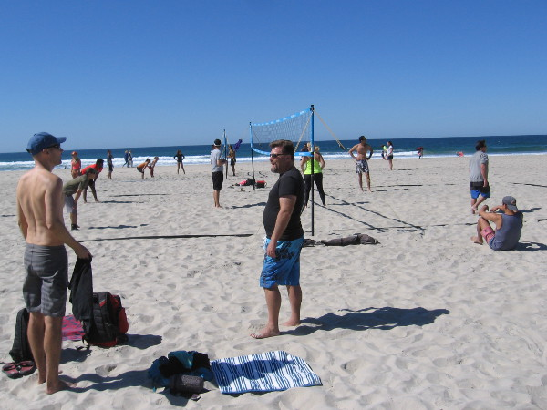 People play on the sandy volleyball courts at South Mission Beach, north of the jetty.