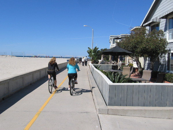 The Mission Beach boardwalk, which passes many small colorful houses and condos, is popular with bicyclists and pedestrians.