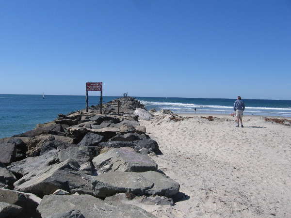 Someone approaches the foot of the rock jetty, which guards the channel into Mission Bay. This area is also called Point Medanos.