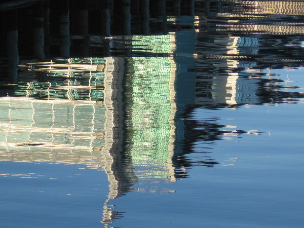 A mysterious, glittering reflection of the Port Pavilion on San Diego Bay.