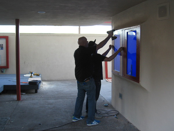 Guys work on an interactive kiosk that will be at the entrance to the renovated Starlight Bowl in Balboa Park!