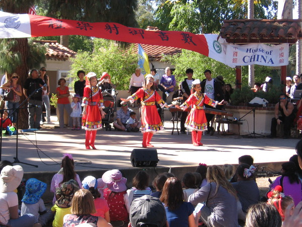 Young students working with the Confucius Institute at San Diego State University dance during the program.