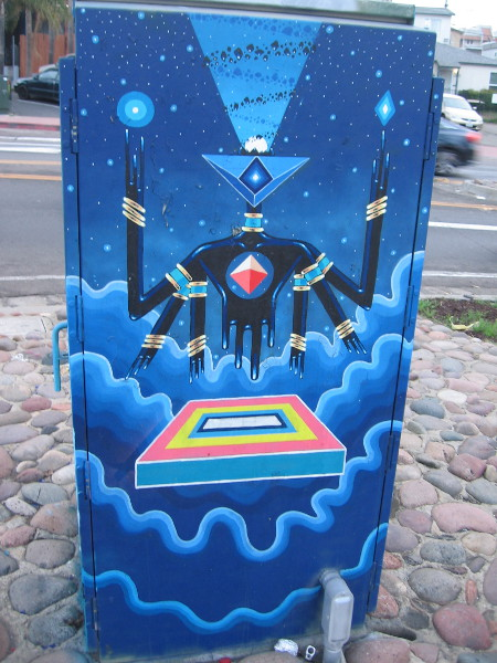 Urban art that seems both ancient and futuristic. Strange geometric patterns in these figures appear symbolic.