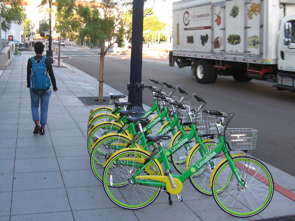 Rows of bright new LimeBike smart bicycles have appeared in downtown San Diego.