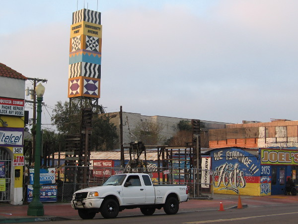 I've crossed the street and am heading back west. I noticed this colorful tower to the south features references to both City Heights and Cherokee Point, a neighborhood south of University Avenue.