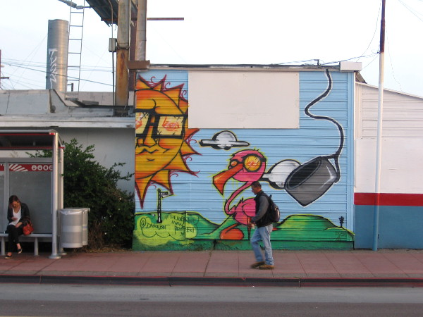 Before crossing this street I spied this fun street mural near another bus stop.