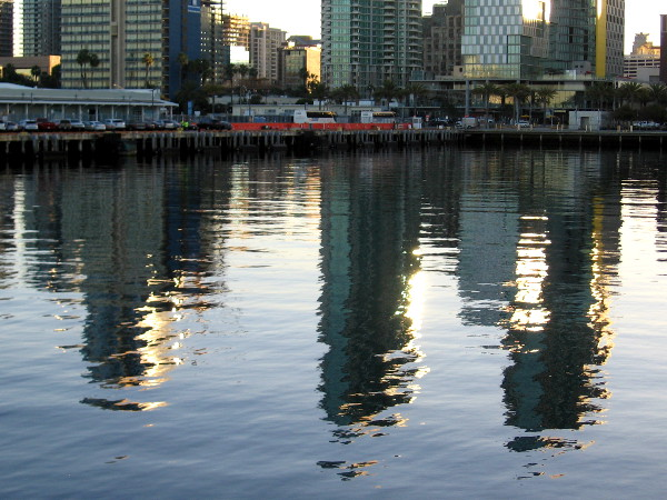 Reflections of buildings along San Diego's waterfront. Like fragments of dancing light, these visions change as years pass.
