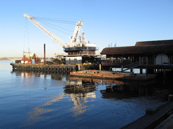 A crane on a barge. The demolition of Anthony's Fish Grotto on the Embarcadero has begun.