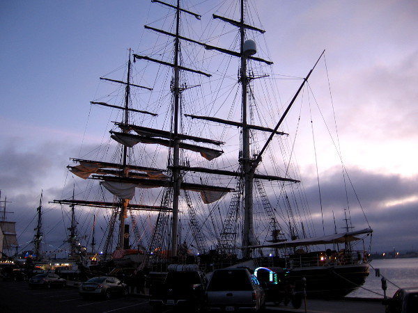 Evening photo of the beautiful tall ship Stad Amsterdam docked on San Diego's Embarcadero.