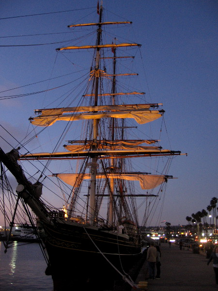 The last rays of sunlight illuminate the furled sails of the amazing tall ship Stad Amsterdam.
