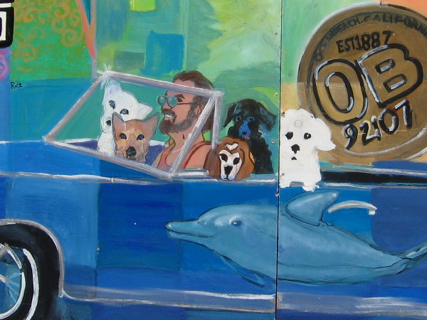 Five dogs ride in a car in an Ocean Beach community mural.