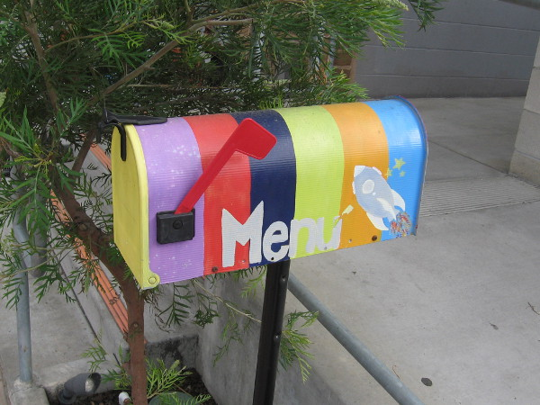 Galaxy Taco's colorful mailbox with their menu.
