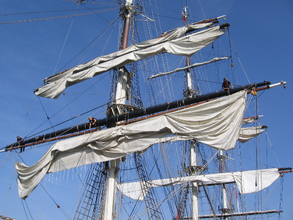The majestic ship has masts that touch the sky.