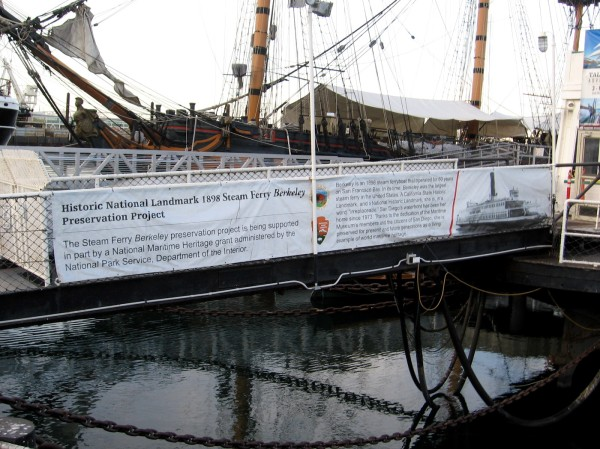 Banner along entrance gangway explains the Historic National Landmark 1898 Steam Ferry Berkeley Preservation Project.