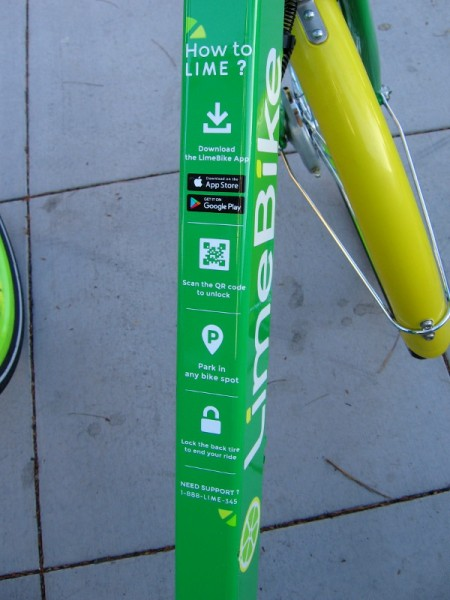 Instructions on a LimeBike show how to scan the QR code to unlock the bicycle.