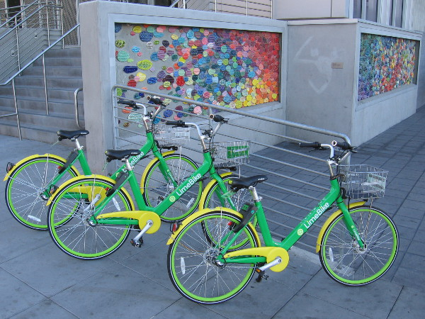 I found more LimeBikes parked on the sidewalk near some colorful public art at the Little Italy trolley station!