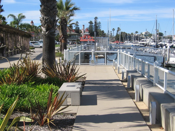 More benches by the bay offer a view of boats in the nearby Glorietta Bay Marina.