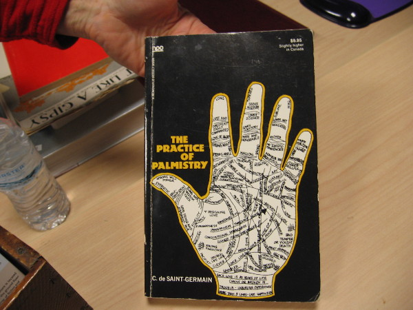 You never know what you'll find in this used bookstore. Perhaps someone would like to learn about The Practice of Palmistry.