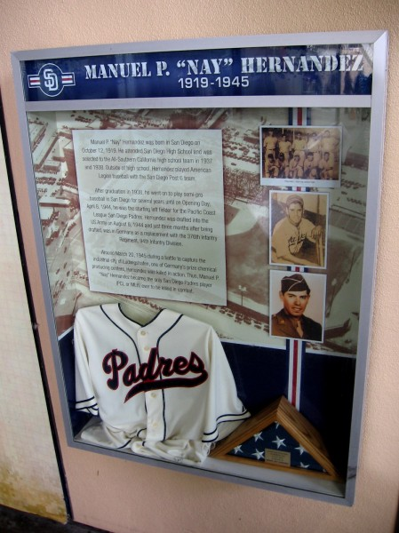 Display inside Petco Park's Power Alley honors Manuel P. Hernandez of San Diego. Before the start of World War II he played for the Pacific Coast League Padres. He died in action fighting the Nazis in Germany.