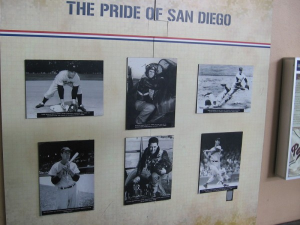 Historical photographs in Petco Park honor The Pride of San Diego. Two legendary Padres players, Ted Williams and Jerry Coleman, are shown on the baseball diamond and serving as pilots during the Korean War.