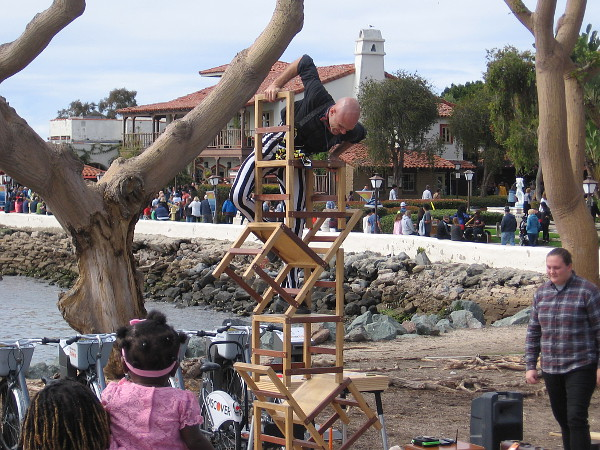 Dango (Derrick Gilday of San Diego) climbs a stack of chairs near Seaport Village.