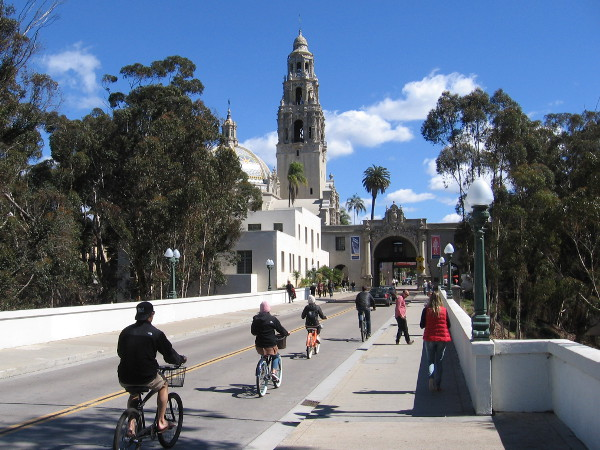 Riding bicycles one sunny Sunday over the Cabrillo Bridge into the heart of Balboa Park.