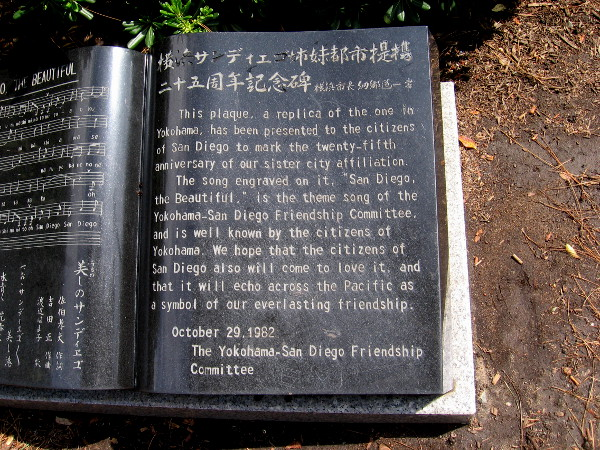 Outside the garden, steps from the entrance is a plaque. It's a replica of one in Yokohoma, sister city of San Diego. The left half contains the theme song of the Yokohama-San Diego Friendship Committee.