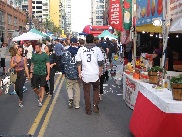 Padres fans enjoy walking along four blocks of J Street near Petco Park. It's the Opening Weekend Block Party in San Diego!