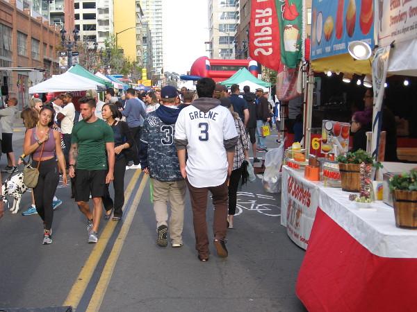 Padres fans enjoy walking along four blocks of J Street near Petco Park. It's the Opening Weekend Block Party in San Diego!