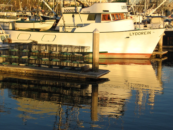 Lobster traps in Tuna Harbor reflected in early evening water.