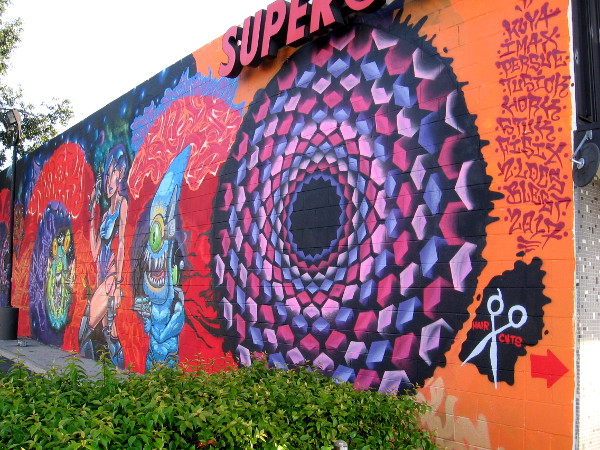 Ten street artists have their names on one side of this fantastic, complex spray paint art in North Park.