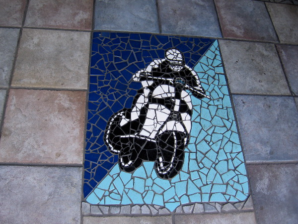 Tile mosaic of a motorcycle and rider. A very cool sight in the sidewalk in front of Belching Beaver Brewery in North Park.